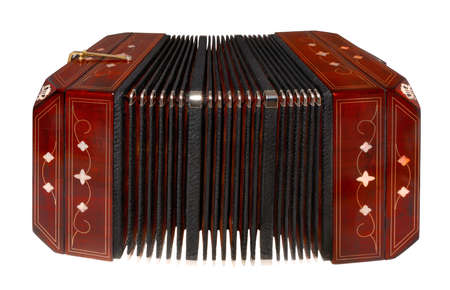 milonga: Slightly open bandoneon on horizontal surface. Isolated on white Stock Photo