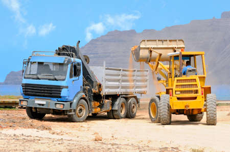 front end loader loading a truck on a shore of Graciosa; Canary islands, Spain Stock Photo - 8683286