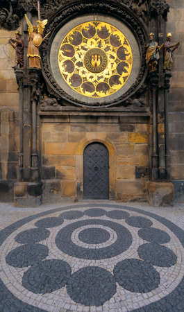 The Astronomical Clock, built in to one side of the Old Town Hall Tower, with a bit of adjucent pawement in front photo