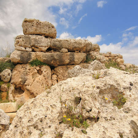 fertility goddess: Partially intact wall of a megalithic temple complex, Ggantija (Ggantia), Gozo, Malta. This neoliic temple was built between c3600 and 2500 BC, we know very little about the builders except they may have been the site of an Earth Goddess fertility cult. t