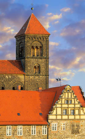 A closeup on a church tower and upper floors of Quedlinburg Castle complex; Quedlinburg, Saxen Anhalt, Germany photo