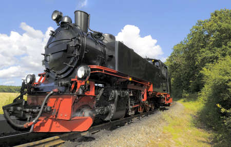 Steam train running on island Rugen, Northern Germany photo