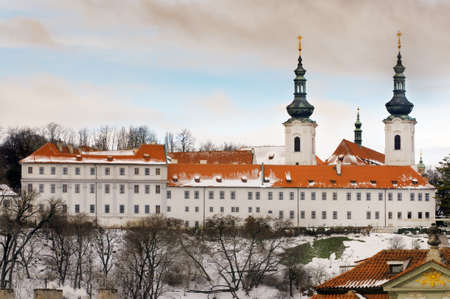 The Strahov Monastery (Strahovsky Klaster) in winter under fresh snow; two church towers belong to Basilica of our Lady; Prague, Chezh Republic photo