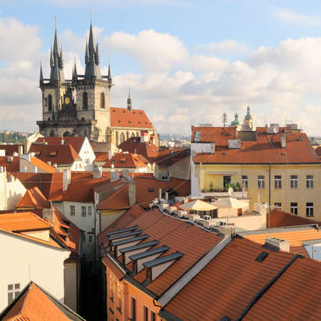 clowds: A view to the Church of Virgin Maria Before Tyn and rooftops; Old Town, Prague, Czech republic  Stock Photo