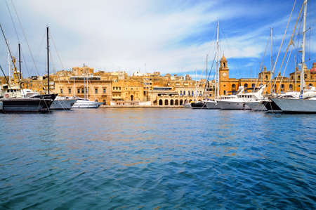 Marina in Vittoriosa, one of the Three Cities across Valetta Bay, Malta; the building with the clock is Maritime Museum