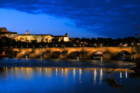 Evening view of Charles Bridge over Vltava river from Novotneho Lavka, Prague, Czech photo