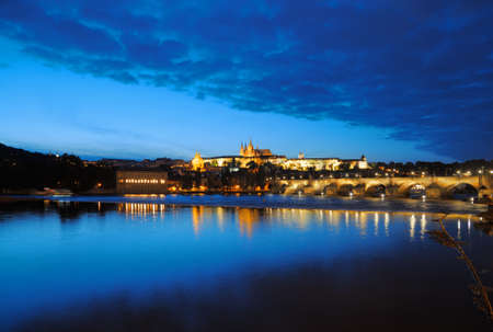 Evening view of Prague Castle and Charles Bridge over Vltava river from Novotneho Lavka, Prague, Czech photo