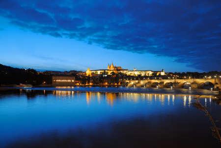 Evening view of Prague Castle and Charles Bridge over Vltava river from Novotneho Lavka, Prague, Czech photo