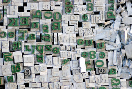 Old letterpress German letters from a flea market, grey and green ones photo