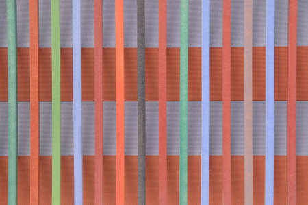 metal base: Colored wooden stripes on perforated metal base, background