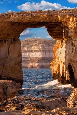 Azure window, natural stone arch by Dwejra cliffs at western  Gozo island, Malta photo