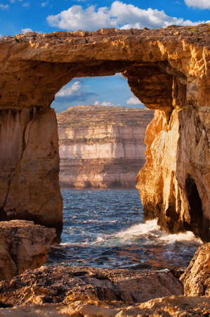 coastal erosion: Azure window, natural stone arch by Dwejra cliffs at western  Gozo island, Malta Stock Photo