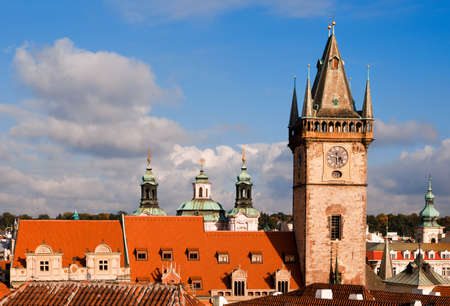 old town square: Town Hall tower, spires of St. Nicholas Church and tiled roofs around  Old Town Square in Prague
