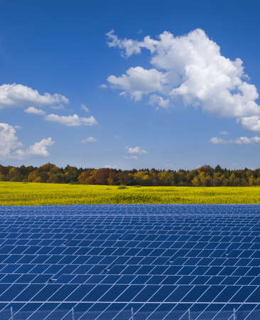 Solar power plant and rapesed field in Autumn; Saxony, Germany photo