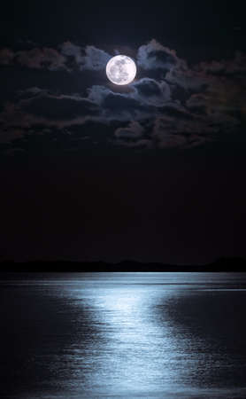 over the moon: Moon over sea at night