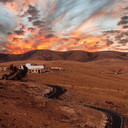 Sunset over a road at Fuerteventura, Canary islans, Spain photo