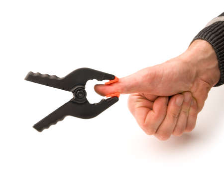 Hand with a clamp on thumb Stock Photo - 12348895