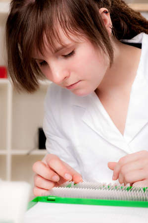 biopsy: Histopathologist selects a biopsy sample for analysis Stock Photo