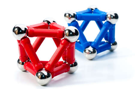 octahedron: Red and blue octahedrons made of magnets Stock Photo