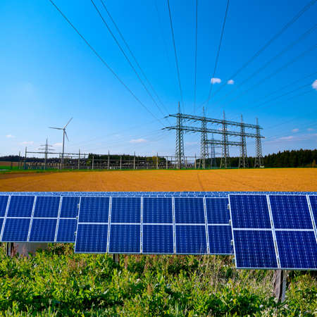 power lines: Solar panels and electric substation with power lines
