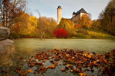 manor: Pond with autumn leaves in Germany Stock Photo