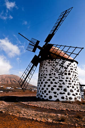 Traditional windmill in La Oliva, Fuerteventura, Canary islands photo
