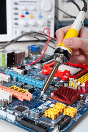 Service worker soldering electronic surcuit connection photo