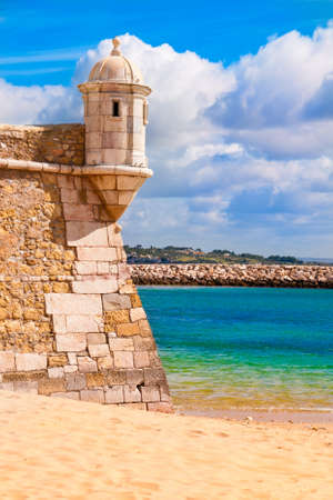 Lagos: Castle of Lagos in Portugal; part of the castle wall with a watch tower next to the sea