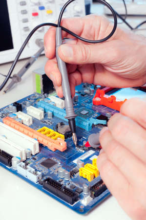 electronics parts: Tech tests electronic equipment in service centre