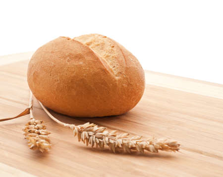 crust crusty: Wheat bread roll on a cutting board Stock Photo