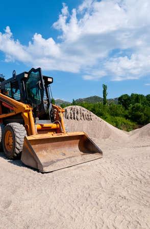 backhoe loader: Yellow wheel loader  Backhoe loader  on cunstruction site in Greece