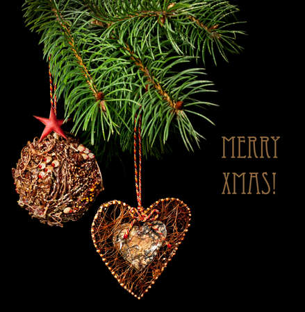 Handmade Christmas tree decorations on black background photo