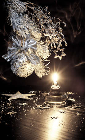 plastic christmas tree: Xmas decorations with a candle Stock Photo
