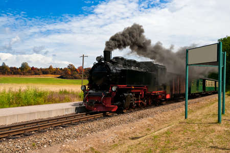 puffing: Steam train with black smoke; island Rugen, Northern Germany  Stock Photo