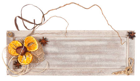 Wooden board decorated with twigs and dried oranges, copy space photo