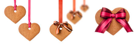 Baked gingerbread hearts decorated  with bows and ribbons on white background Stock Photo - 16382467