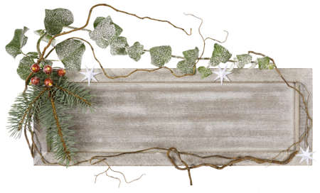 Wooden board decorated with ivy, spruce and artificial berries photo