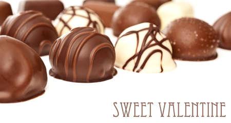 white truffle: Row of chocolate pralines on white background