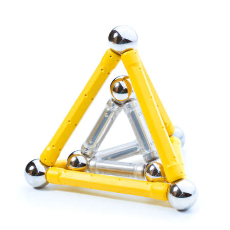 Closeup on two pyramide shapes one inside the other on white background Stock Photo