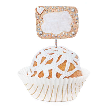 cake pick: Cupcake decorated with white marzipan and a nametag isolated on white