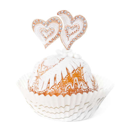 cake pick: Cupcake decorated with white marzipan and two hearts isolated on white