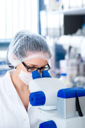 Young attractive microscopist works in scientific laboratory Stock Photo - 18349105