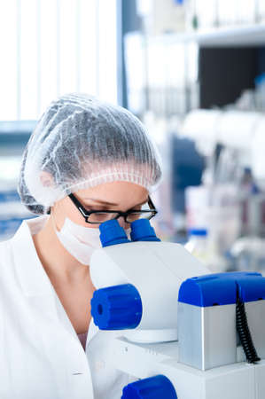Young attractive microscopist works in scientific laboratory Stock Photo - 18349105