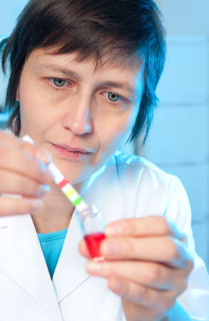 ph: Portrait of a senior scientist or tech measuring pH of a sample