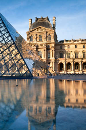 Paris  The glass pyramids in the Napoleon courtyard of the Louvre reflected in calm water