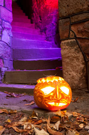 Jack OLantern guarding illuminated staircase photo