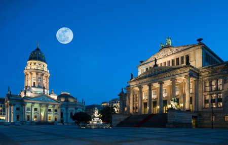 dom: Gendarmenmarkt square in Berlin under a harvest Moon