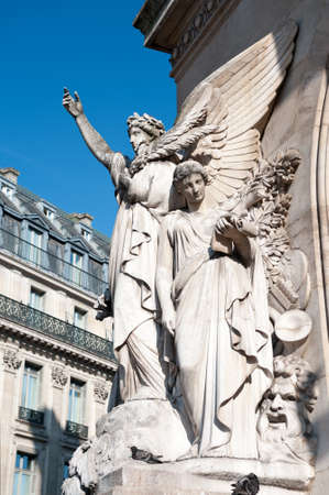 Side view on the sculpture on the Facade of Palais Garnier Opera House in Paris photo