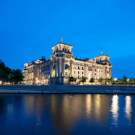 night shift: The Reichstag building  Bundestag  with reflection in river Spree at night