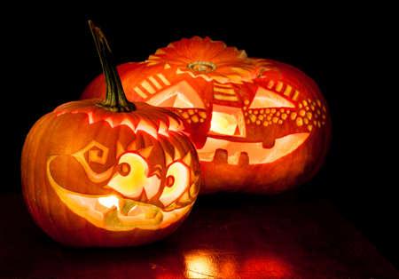 jack o lantern: Halloween pumpkins with candles inside on black background Stock Photo